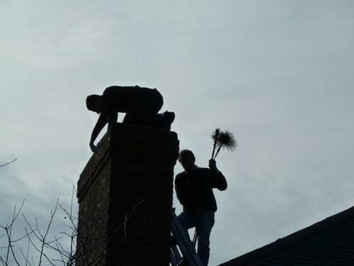 Chimney sweeps on roof